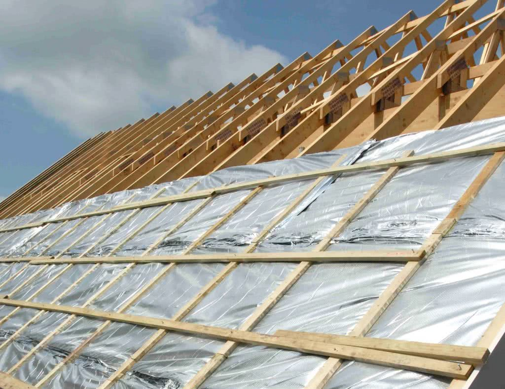 Foil sarking on timber frames during building of new home