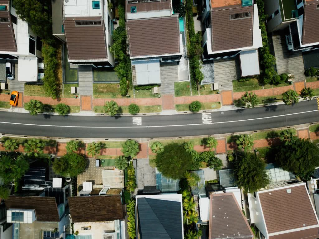 Aerial photograph of suburban houses with a road running through the middle