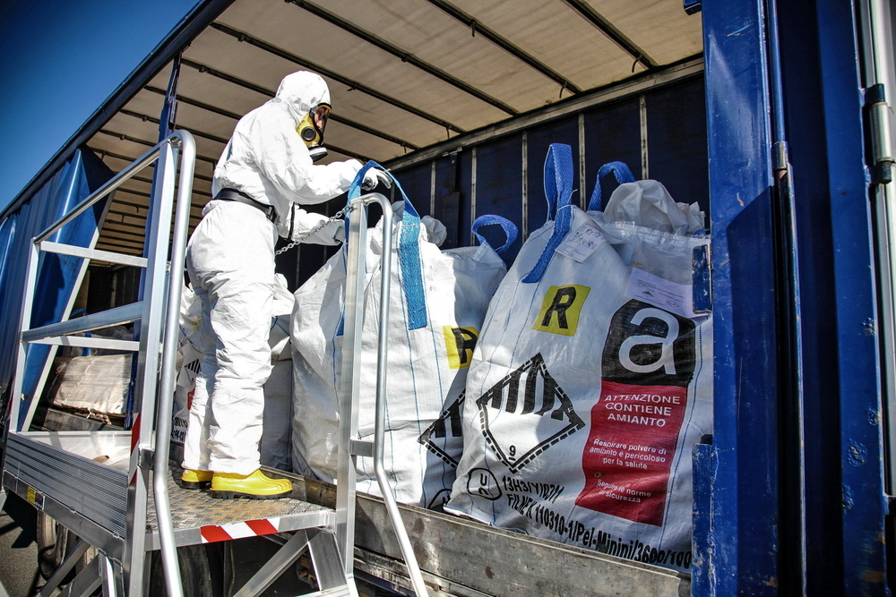 Removal of asbestos into truck which is a consideration of knocking down and building a home