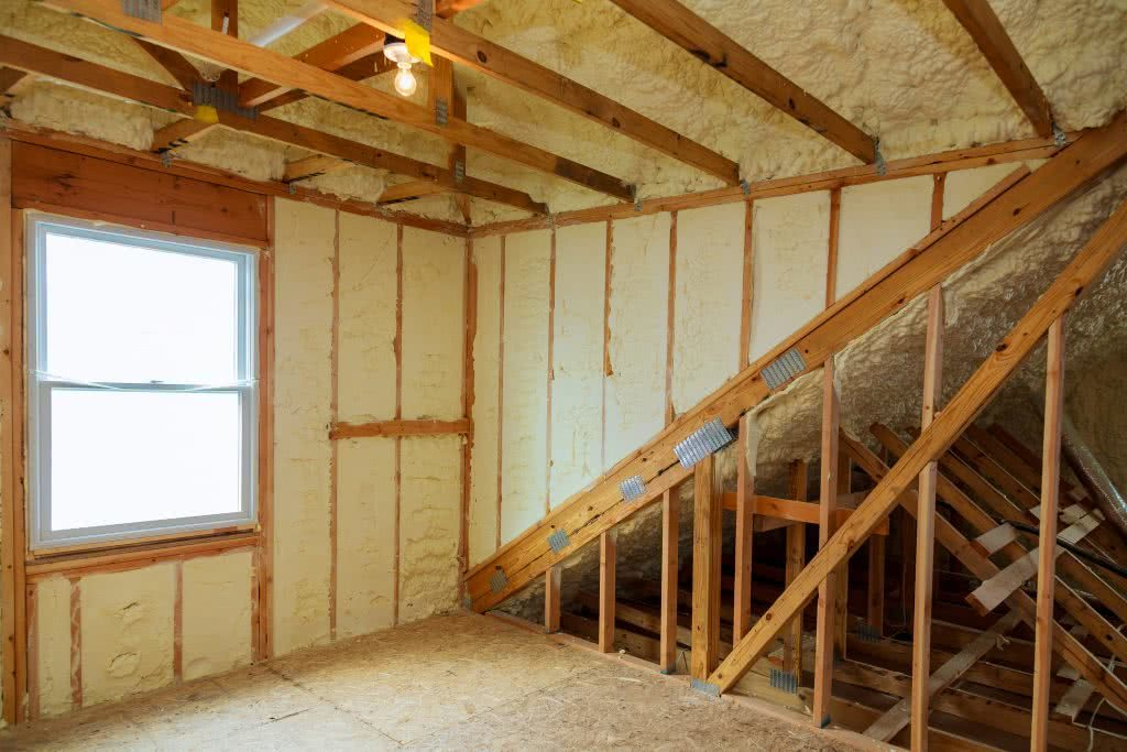 Yellow insulation batts during the building of a new home